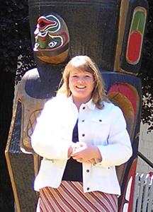 me by a totem pole