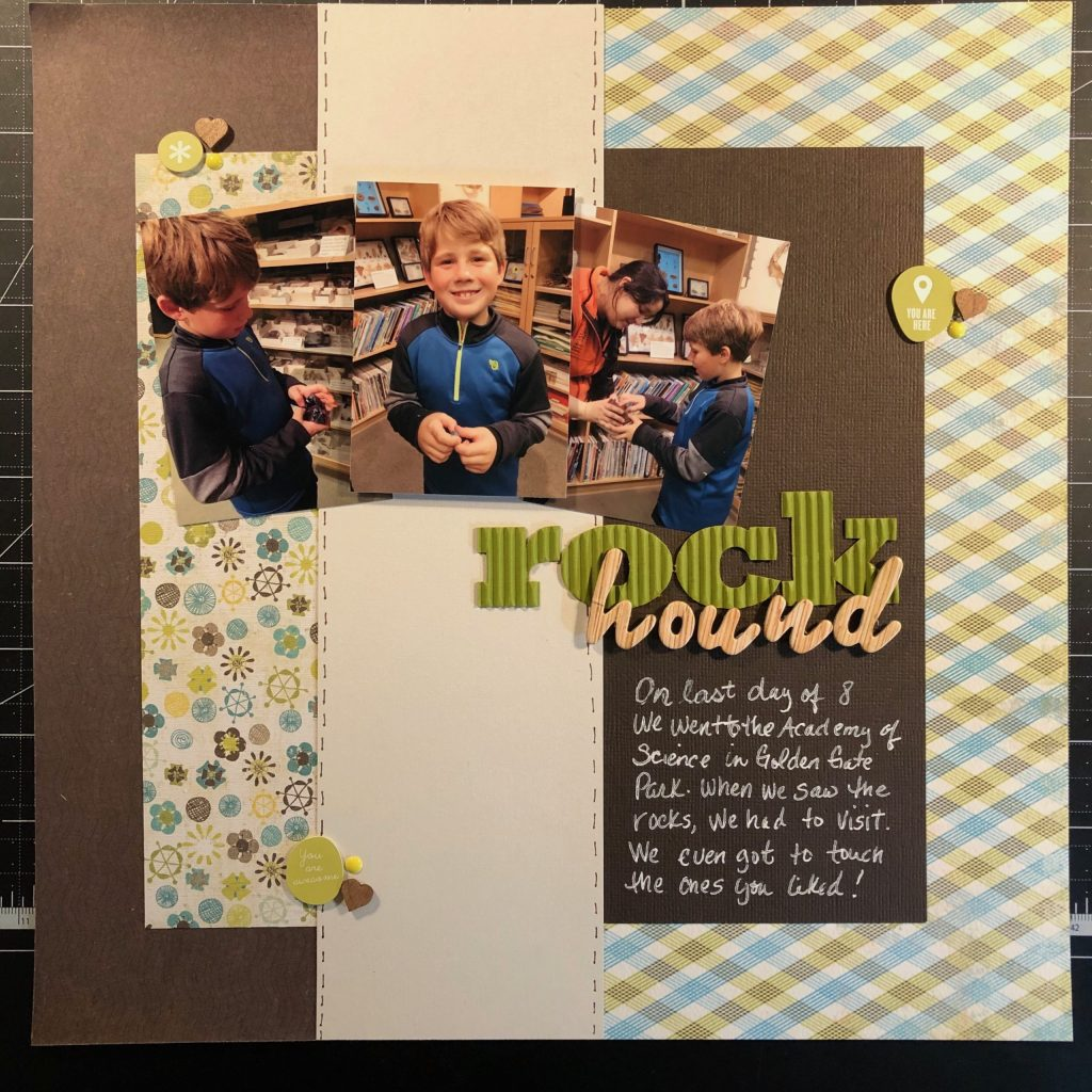 Scrapbook layout of Sean holding rocks.