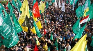 Aksi Massa di Tepi Barat merayakan 25 tahun lahirnya gerakan perlawanan Hamas pada 14/12/12 (foto: bbc)