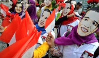 Relawan Jokowi-JK saat melakukan aksi damai.  (Republika.co.id)