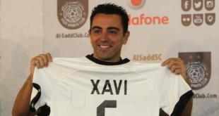 Xavi Hernandez dengan kaos barunya. (l3.yimg.com)