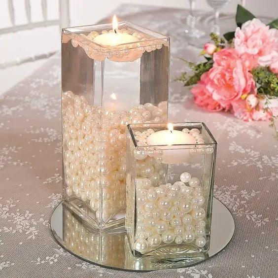 hermosos centros de mesa con velas flotantes dale detalles. Black Bedroom Furniture Sets. Home Design Ideas
