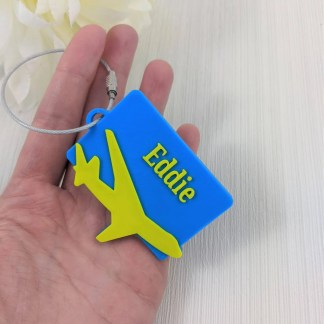 Personalised aeroplane luggage tag in blue and yellow
