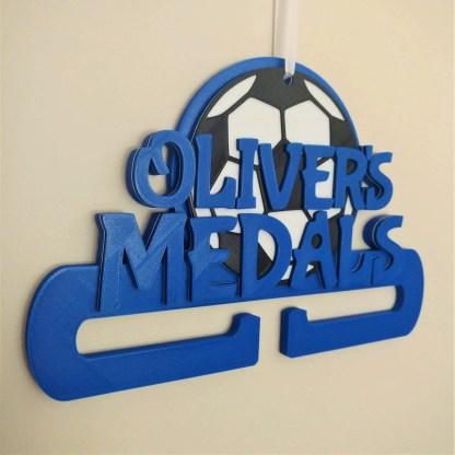 Football themed medal holder in blue