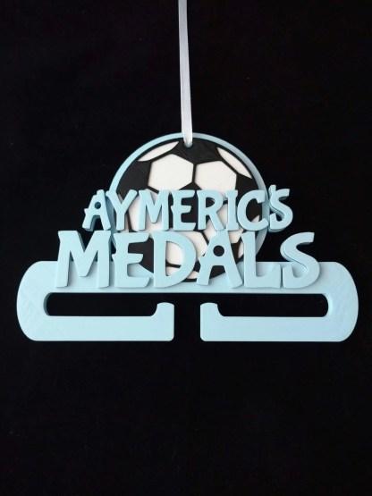 Football themed medal holder in pale blue