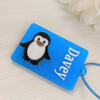 Penguin themed luggage tag in blue
