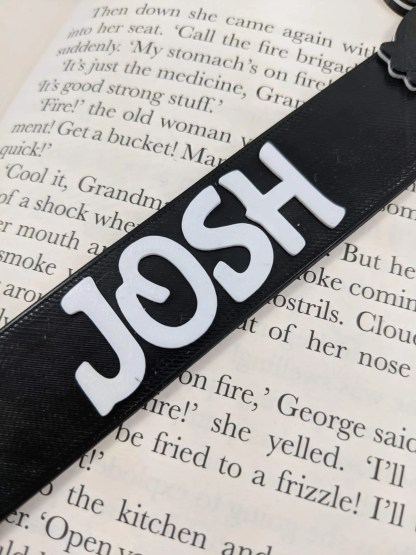 Personalised penguin book mark in black
