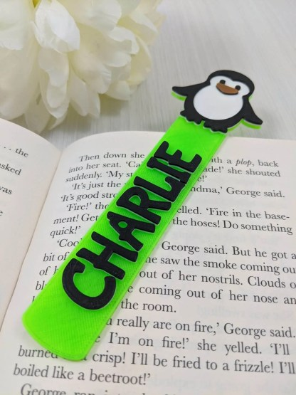 Personalised penguin book mark in fluorescent green
