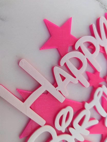 Cake topper with name and stars