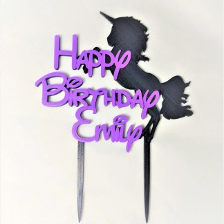 Cake topper with unicorn and message saying Happy Birthday then name