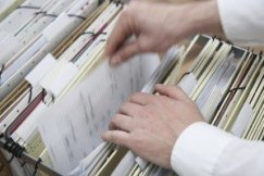 Chicago Social Security attorneys - Man Looking Through Files