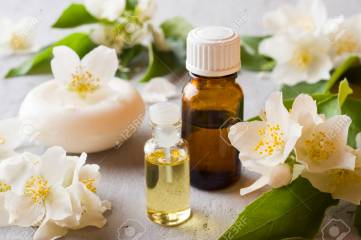 Jasmine oil. Aromatherapy with Jasmine oil and soap. Jasmine flower.