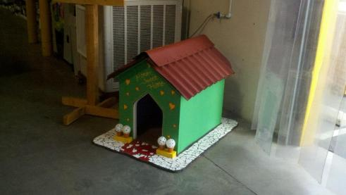 """Habitat Committee member Teresa Dolan of ESRI came up with idea to build doghouses, and auction them off as a fundraiser at Habitat's """"Journey of Hope"""" Gala."""