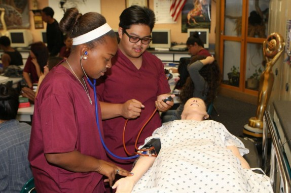 """Canyon Springs Health Careers Academy  students with the simulation Makiken """"Annie"""" are Agienna Lewis and Anthony Ordinario"""