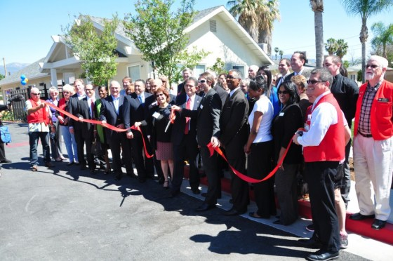 Judi Penman, President and Chief Executive Officer at San Bernardino Chamber of Commerce leads the Ribbon Cutting.