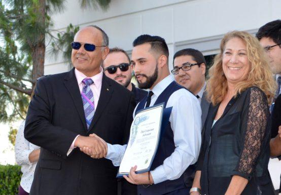 City of Ontario Mayor Paul Leon handing TCA Partner Nick Sanchez a plaque. Left to right: Mayor Paul Leon, Nick Sanchez