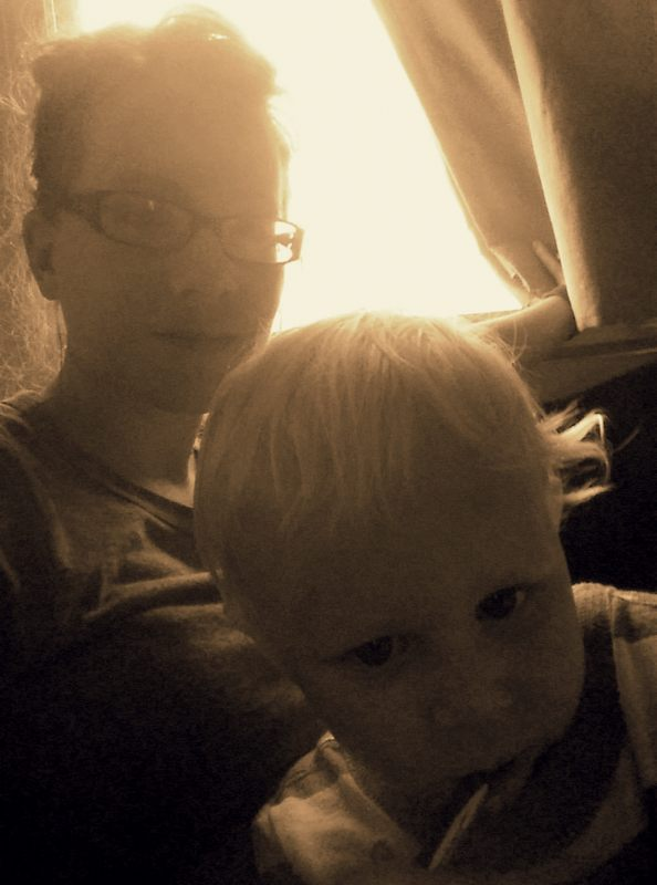 An extremely bad photo quality of Eliot and me chilling with TV and chewing a pen.