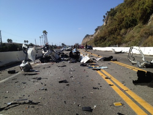 Wreckage from a four-car accident on Coast Highway between Beach Road and Camino Capistrano is scattered across the roadway Sunday afternoon. The driver and passenger of the Volkswagen Jetta (seen here) were killed. Photo Courtesy of the Orange County Fire Authority.
