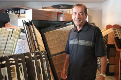 Gene DeCollibus, owner of Lantern Bay Carpets and Drapes, nears his 30 year anniversary on the Dana Point business scene. Photo by Andrea Papagianis
