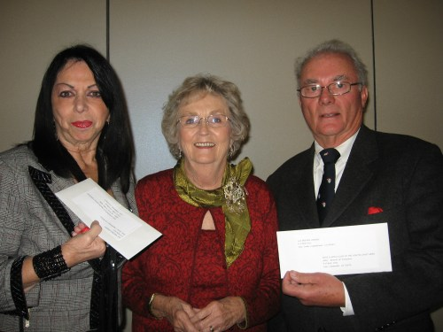Outgoing president of Las Buenas Amigas, Marj Knudson (center), presents directors Alicia Fiori and Robert Adams, of RIO-Leo Fessenden CBAS and the Boys & Club of the South Coast Area, respectively, with donations. Courtesy photo