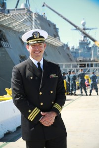 Cmdr. John Kochendorfer, a Dana Point native, stops for a picture March 10 as one of the U.S. Navy's newest and most advanced vessels, the USS Coronado, arrived in its home port of San Diego. Photo courtesy of the U.S. Navy, by Senior Chief Mass Communication Specialist Gary Ward