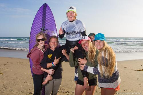 Emmy Merrill of San Clemente is chaired by friends and fellow competitors following her Pro SUP Surf win at the US SUP Tour event March 22-23 in Huntington Beach. Photo by Jack McDaniel/US SUP Tour