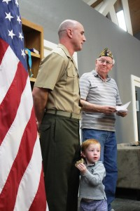 Lt. Col. Richard Viczorek thanks members of VFW Post 9934 for their support. Also pictured, post commander Maurice Hansen and Viczorek's 1-year-old son Jack. Photo by Andrea Papagianis