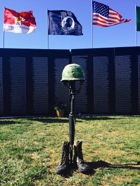 A fallen soldier battle cross sits before a memorial wall honoring servicemen and women who died in the Vietnam War. Photo: Andrea Papagianis