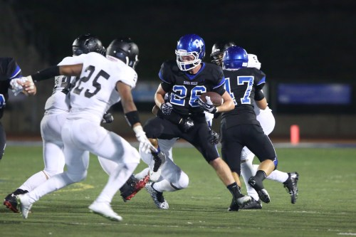 Dana Hills senior running back Brian Scott (26) carries the ball against Tustin on Aug. 29. Photo: Tony Tribolet/www.xpsphoto.com.