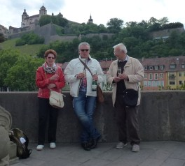 Members of the Kirsch family make a toast on a bridge in Wurzburg, Germany. Photo: Courtesy of Tom Blake