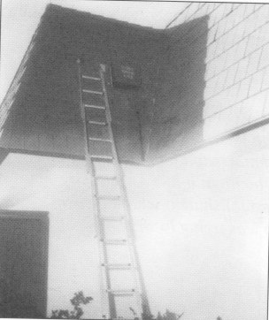 This is an evidence photo of a ladder with the name Mel Pierce written on it that was stolen from South Shores Church and found at the scene of the crime. Photo:  Courtesy of the Olvera Collection