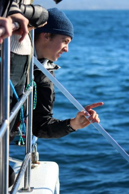 Dana Hills student Shaun Phaneuf deploys two GoPro cameras affixed to an 8-foot pole to capture underwater footage of dolphins. Photo: Krista Snow