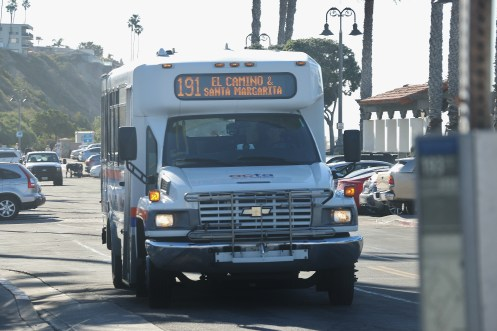 An Orange County Transportation Authority Bus on the 191/A route stops at the Metrolink Station in North Beach on Wednesday morning. The OCTA Board of Directors approved a plan to eliminate the 191 and 193 routes, which service riders from San Clemente to Mission Viejo, in October. Photo: Eric Heinz