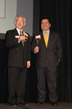 Incoming Chairman Mits Arayama (left) and Outgoing Chairman Enzo Scognamiglio share a toast at the Chamber of Commerce's Annual Meeting and Installation Dinner. Photo: Andrea Swayne