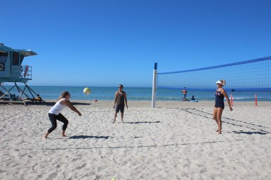 Jen Kessy, right, instructs Dana Point Times reporter Franki Darnold, left, and other journalists on proper serve and passing technique. Photo: Megan Quilici