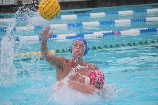 Adam Cole passes the ball during a boys water polo practice. Photo: Steve Breazeale