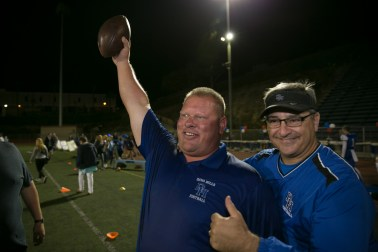 Dana Hills football coach Phil Skinner celebrates the Dolphins win over Los Amigos Sept. 23. Photo: Alan Gibby/zone57