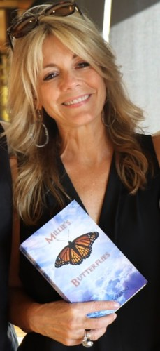 Dana Point resident and author Dori Scarano holds her book Millie's Butterflies. Photo: Courtesy of Jeff McDowell