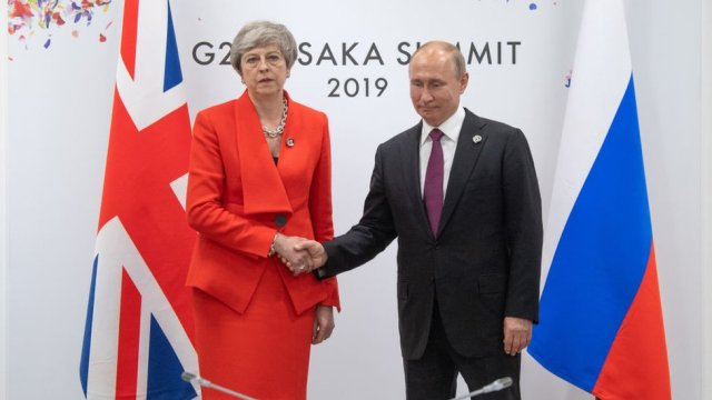 Theresa May shaking hands with Vladimir Putin