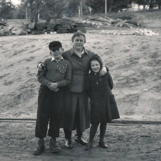 Female guard Johanna Langefeld with her son and another guard's daughter