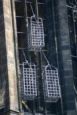 The original cages still hang on the steeple of St. Lambert's Church in Münster