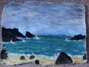 Wet felt picture with detailed needle felted on to it. A scene of Split rock at Clachtoll, Sutherland.