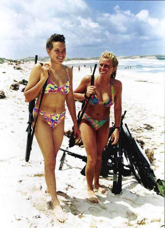 two marines enjoy the beach