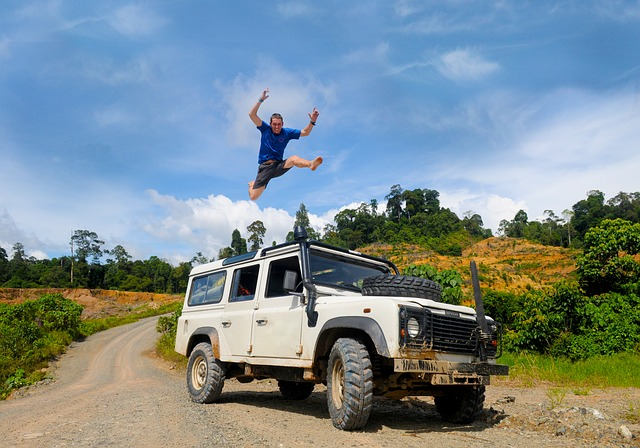Man jumping over jeep