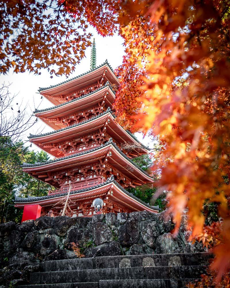 A beautiful red pagoda temple, part of the Shikoku Pilgrimage through Kochi