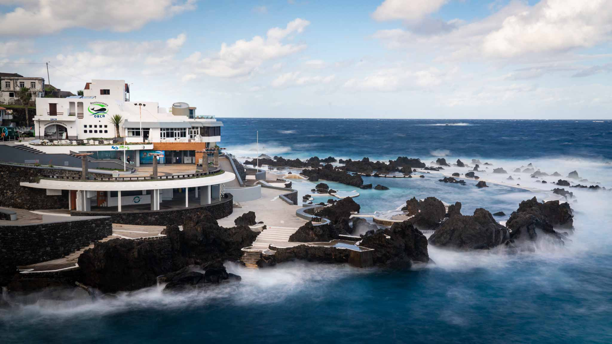 The ocean swimming pools of Porto Moniz surrounded by the sea and light waves