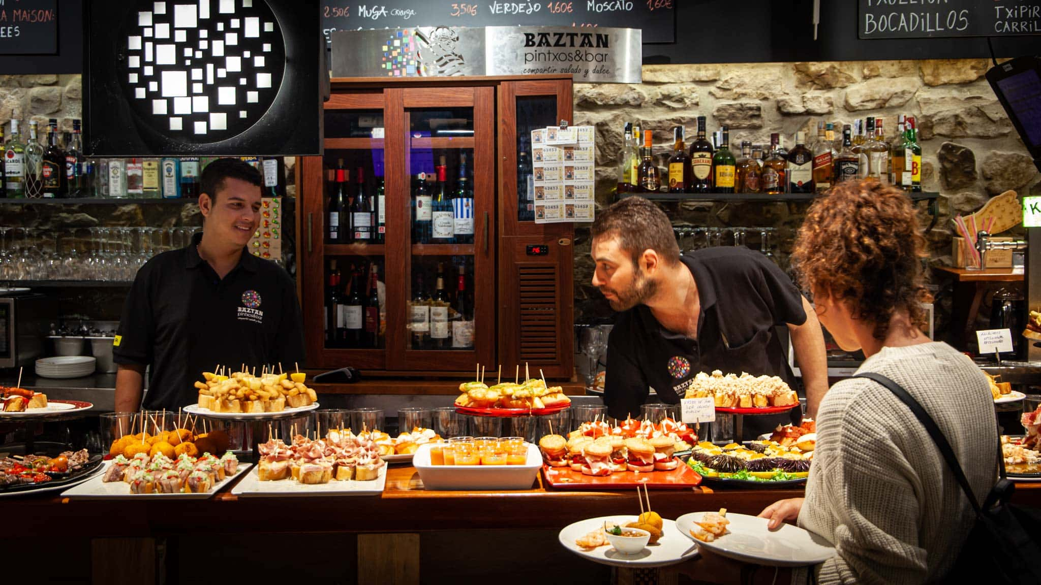 Helping yourself to Pintxos on a bar in San Helping yourself to Pintxos on a bar in San Sebatsian
