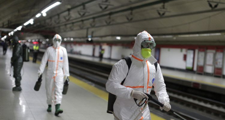 Members of the Military Emergency Unit disinfect Nuevos Ministerios subway in a bid to prevent the spread of COVID-19 in Madrid, Spain, Friday, March 20, 2020. For most people, the new coronavirus causes only mild or moderate symptoms. For some, it can cause more severe illness, especially in older adults and people with existing health problems. (AP Photo/Manu Fernandez)