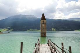 28173554 - resia (bolzano, trentino alto-adige, italy): the famous tower in the lake and wooden pier