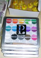 Chalks, ink pads, paint brushes, arts supplies, embellishments and stickers